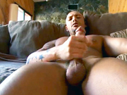 Bald guy jerks his huge dick