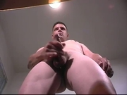 Tall guy masturbates and makes himself cum