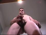 Tall guy masturbates and makes himself cum