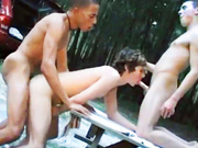 3 guys sucking and fucking on a picnic table