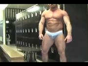 Body builder beefcake muscle stud shows off