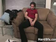 Hot guy spanking the monkey on the sofa