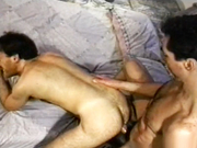 2 hairy guys fuck on the bed