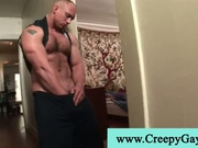 Huge muscled guy goes to wake up his friend