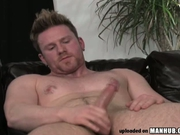Beefy guy masturbates in front of the camera