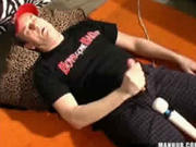 Daddy lays on the floor and uses a vibrator